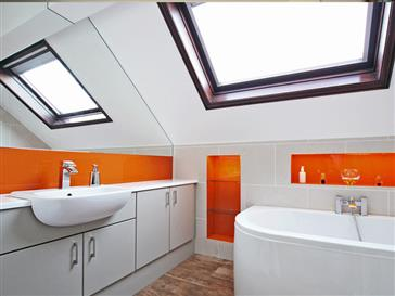 Modern bathroom with orange acents